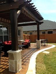 Backyards Ideas Patios by Rock Salt Patio With Cedar Pergola And Stone Border And Stone