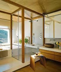 zen bathroom design with walk in shower and wall mounted vanity
