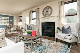 an inviting fireplace framed by large windows welcomes you home