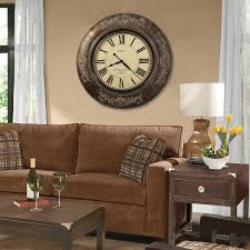 decorating le chateau oversized wall clock with brown sofa and
