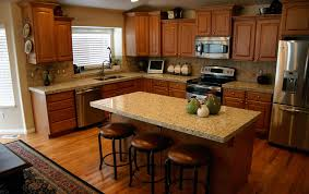 giallo fiorito granite with oak cabinets ornamental granite
