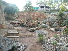 limestone retaining walls with limestone boulders to match and
