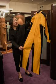 bruce yellow jumpsuit bruce s iconic yellow jumpsuit up for auction reporter