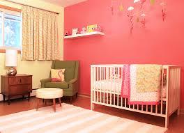 a retro modern pink flamingo themed nursery for baby retro