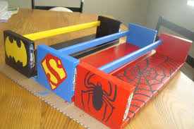 ikea bekvam shelves painted for each super hero for his books