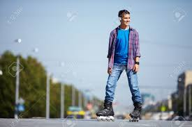 image happy teenager on roller skates in city stock photo