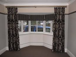 help how would you solve this bow bay window treatment dilemma