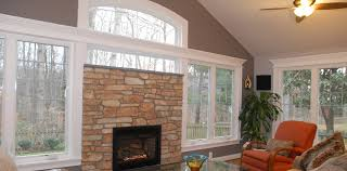 fireplace and arched windows commonwealth home design