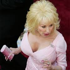 chatter busy dolly parton breast implants