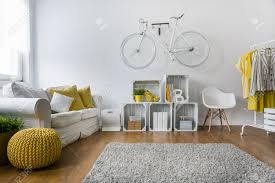 Modern Furniture Living Room Wood Modern Living Room With Sofa Carpet Wood Panels And Bike Hanging
