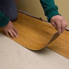 laying vinyl flooring on floor for installing luxury vinyl