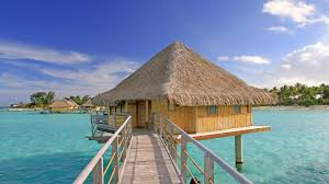 perfect water villa bungalow over clear blue lagoon ocean bora