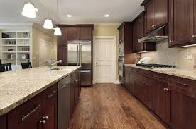 what color floor goes with brown cabinets brown kitchen with wood floors kitchen design kitchen