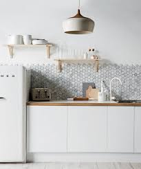 white kitchen cabinets with hexagon backsplash photo 2 of 7 in winter white kitchens and bathrooms by diana