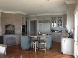 custom hand painted wood grained cabinets in a soft driftwood