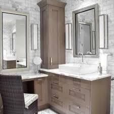 custom master bathroom with double corner vanity tower cabinet