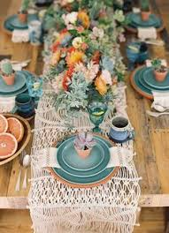 table setting western style cactus runner as the centerpiece for a summer dinner with friends