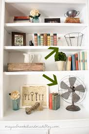 how to style a bookcase how to decorate style bookshelves megan brooke handmade