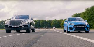 bentley vs chrysler logo drag race ford focus rs vs bentley suv ford authority
