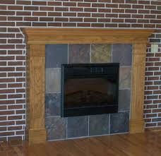 simple exposed brick wall fireplace with wooden bookshelves also