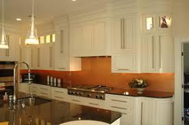 kitchen copper backsplash copper backsplash white cabinets black counter silver sink