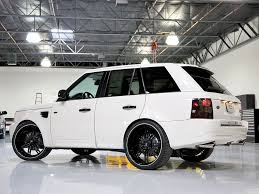 white land rover lr4 with black wheels 08 range rover sc 24