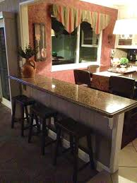 Building A Kitchen Island With Seating by Turn That Half Wall Into A Breakfast Bar Additional Seating