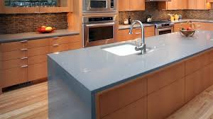 island kitchen counter waterfall edge countertop why it belongs in your kitchen
