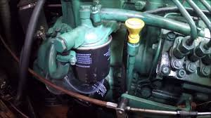 how to change the diesel filter and pre filter on a volvo d2 55