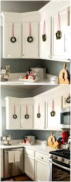 christmas decorations for kitchen cabinets decorating with wreaths indoors mini wreaths on kitchen cabinet