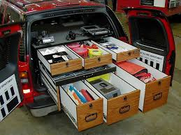 survival truck gear ideas for suv storage including secure long gun storage