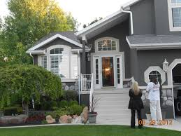 dark gray stucco home painted by certapro painters of west salt