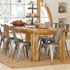 love this farm style dining room table and stainless steel chairs