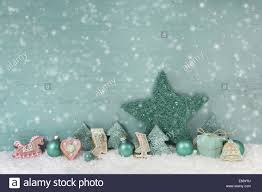 Mint Green Color Snowy Merry Christmas Background In Mint Green Color With