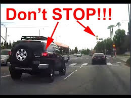running a red light ticket in california car begins stopping at intersection before yellow light turns on