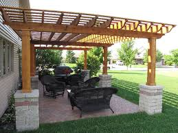 Backyard Brick Patio Design With 12 X 12 Pergola Grill Station by Experts At Decks Patios Pavers Fireplaces Fire Pits Gazebos