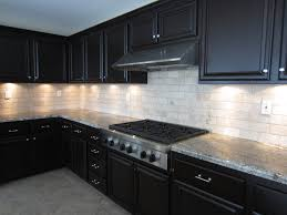 25 best espresso kitchen cabinets ideas on pinterest espresso eye catching white stone subway backsplash with espresso cabinets and grey marble countertop as decorate in l shaped modern kitchen ideas