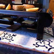 raclette cheese whole foods swiss raclette mini raclette machine from whole foods melting