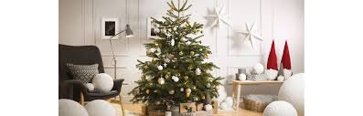 elegant christmas tree in silver and gold over black background