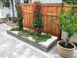 Building A Raised Patio With Retaining Wall by Retaining Walls Terraces Planters Villa Landscapes