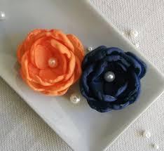 navy blue flower orange flower tangerine flower bridesmaids