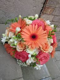 wedding bouquet of freesia roses gerbera daisies and baby u0027s