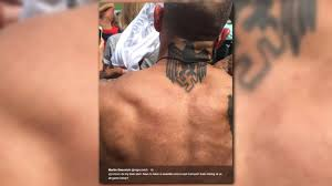 tattoos for men indian father son get controversial view at cleveland indians game