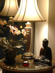 photos hgtv asian influenced table with buddha statue loversiq photos hgtv asian influenced table with buddha statue