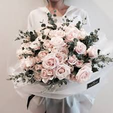 how much is a dozen roses bouquet arrangement two dozen roses branches of eucalyptus