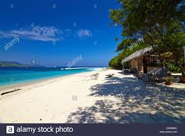 tropical beach bungalow on ocean shore gili meno lombok