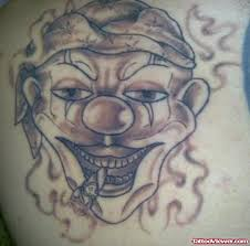 grey ink clown gangster tattoo on back tattoo viewer com