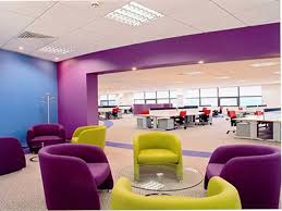 impressive colorful office design with cozy purple armchair and