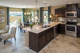 love the tile floors and the dark cabinets kitchen dining living