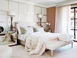 modern bedroom with mirrored nightstands and tall bedside lamps modern bedroom with mirrored nightstands and tall bedside lamps also white comforter